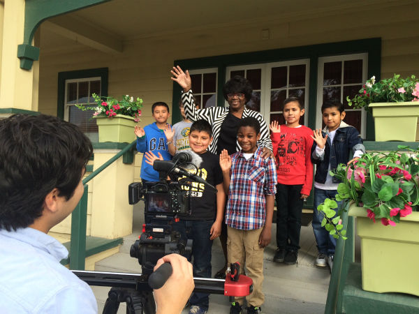 <div class='meta'><div class='origin-logo' data-origin='none'></div><span class='caption-text' data-credit=''>Flora Johnson and students wave to camera for our PSA shoot</span></div>