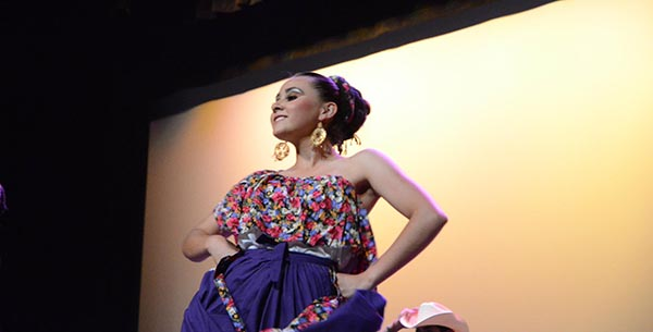 <div class='meta'><div class='origin-logo' data-origin='none'></div><span class='caption-text' data-credit=''>Mariela became involved with the UCSB folklorico group</span></div>