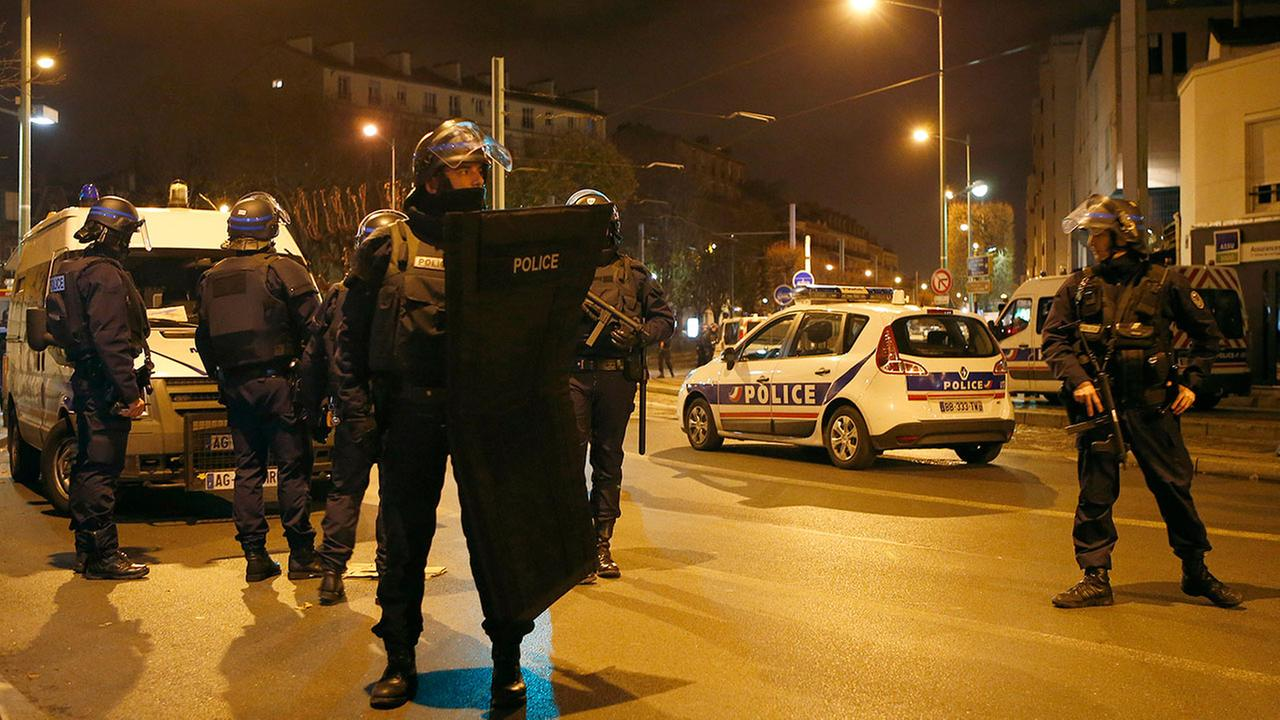 Police forces prepare in Paris, Wednesday, Nov. 18, 2015 after reports of a shooting in the northern suburb of St. Denis.(AP Photo/Francois Mori)