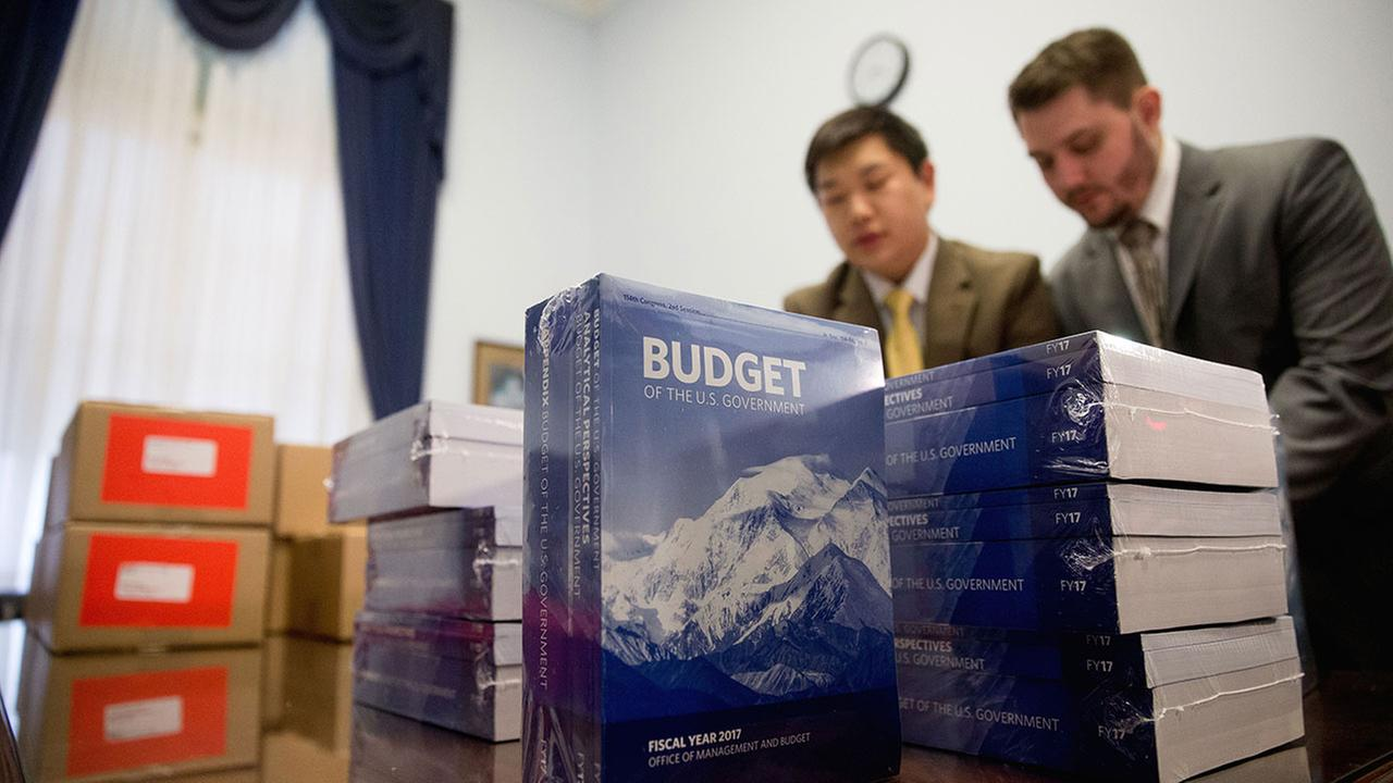 Copies of the President Barack Obamas fiscal 2017 federal budget are unpacked after being delivered to the House Budget Committee Room