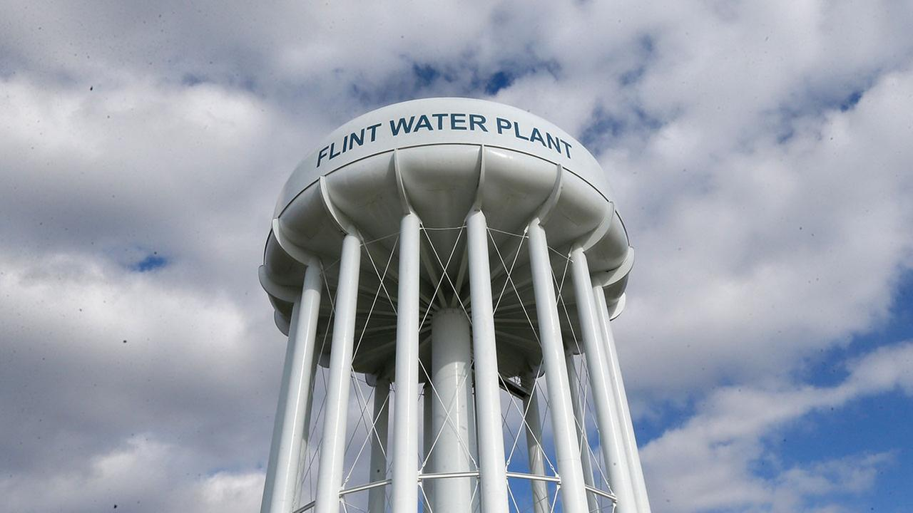 In a March 21, 2016 photo, the Flint Water Plant water tower is seen in Flint, Mich. (AP Photo/Carlos Osorio)