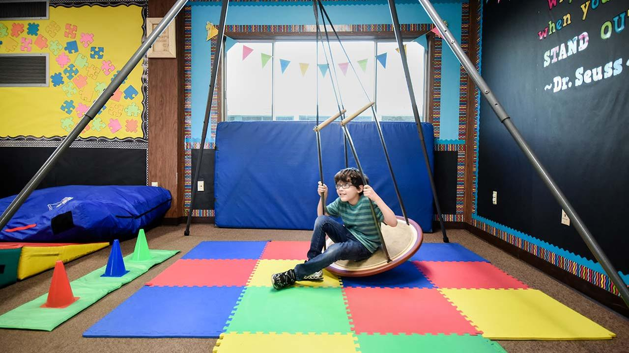 John Dylan JD Ronk tries out a new swing at Gabbys Room, a new sensory/motor skills center for the autistic program at Heaton Elementary School.