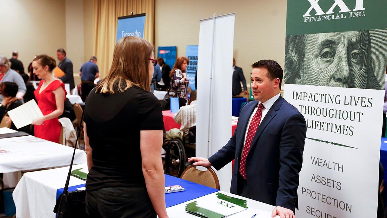 Recruiters speak to attendees at a job fair in Pittsburgh. On Friday, May 6, 2016, the U.S. government issues the April jobs report.