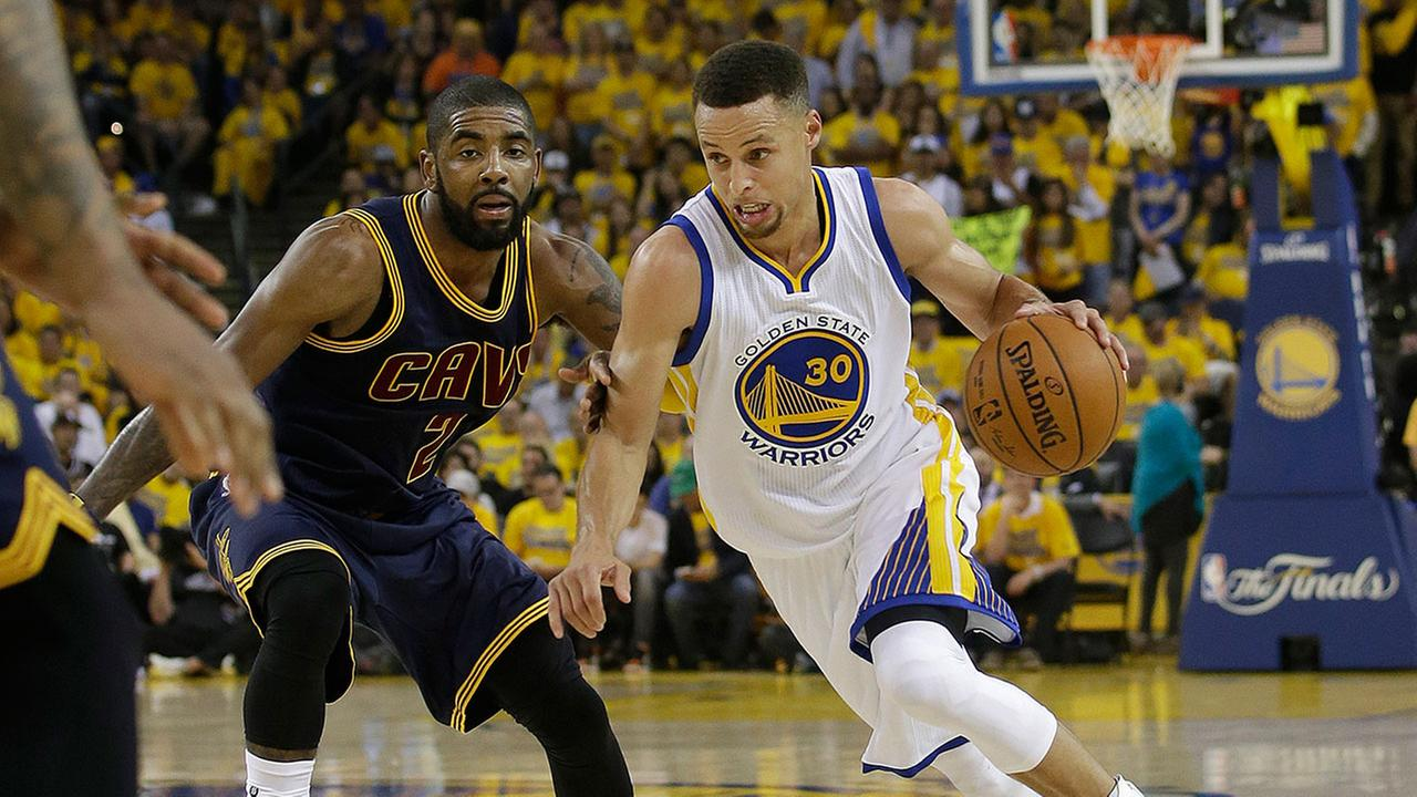 Golden State Warriors guard Stephen Curry (30) dribbles against Cleveland Cavaliers guard Kyrie Irving (2) during the first half of Game 1 (AP Photo/Marcio Jose Sanchez)