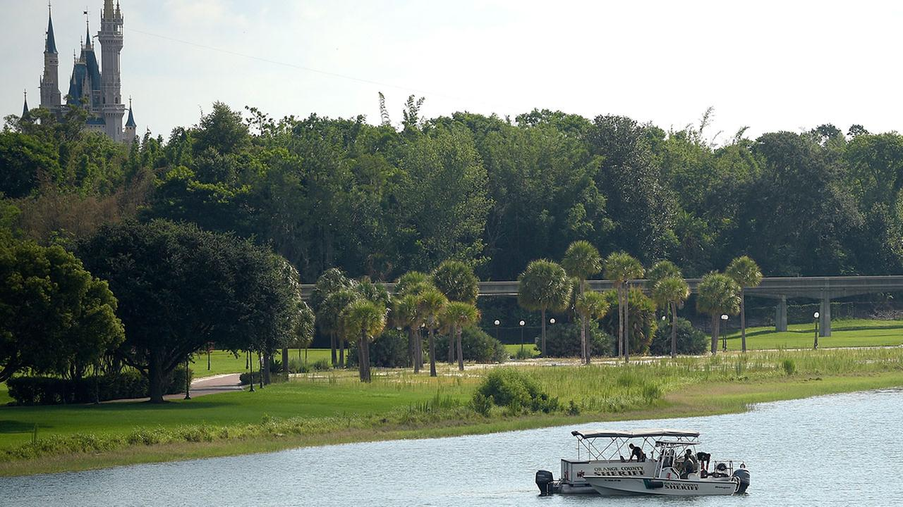 Orange County Sheriffs officers searched the Seven Seas Lagoon between Walt Disney Worlds Magic Kingdom and the Grand Floridian Resort and Spa (AP Photo/Phelan M. Ebenhack)