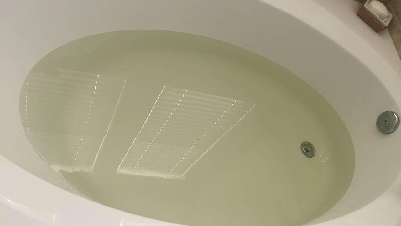 Discolored water shown in a Clovis Bathtub.