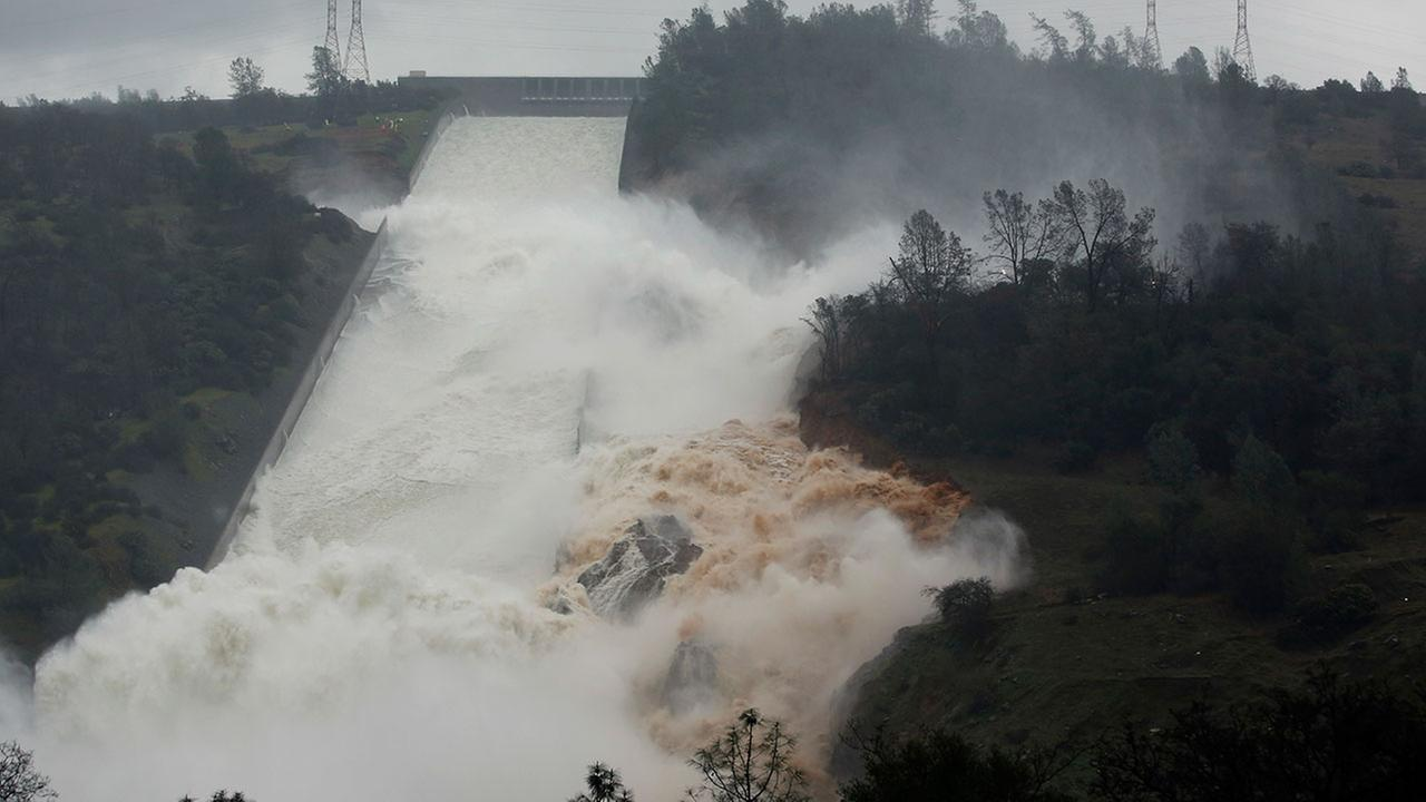 Water flows through break in the wall of the Oroville Dam spillway, Thursday, Feb. 9, 2017, in Oroville, Calif.