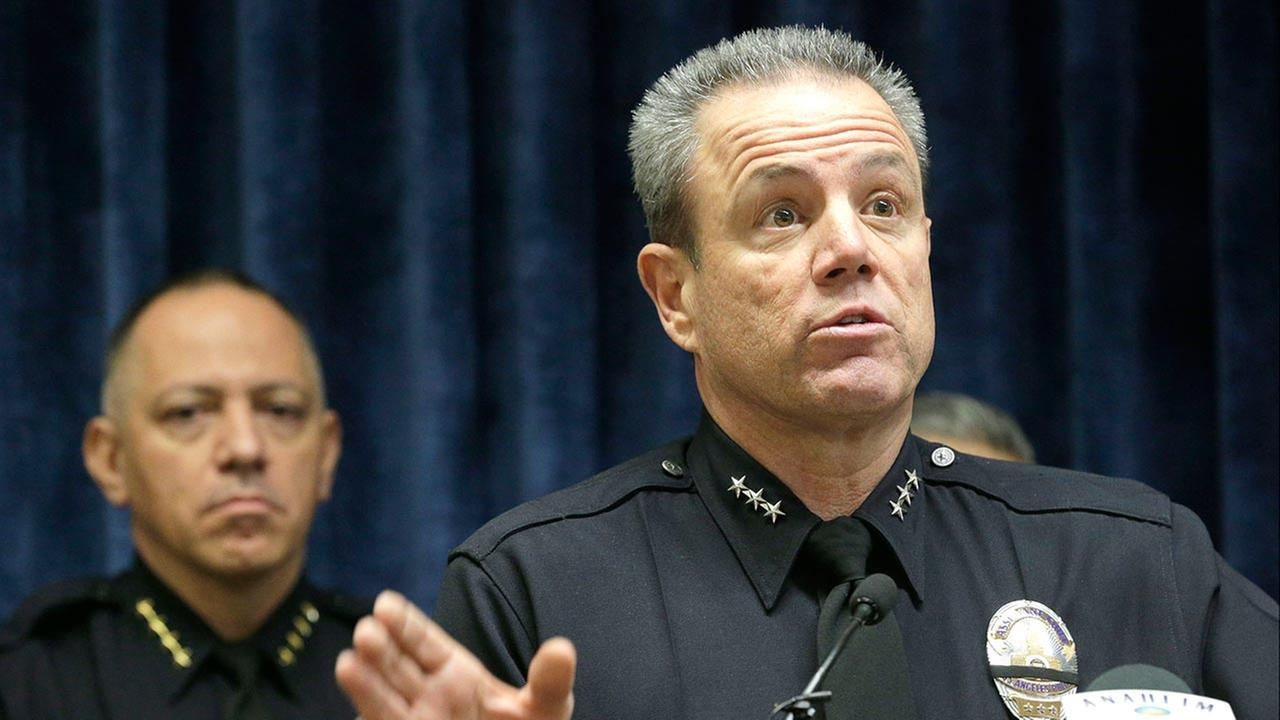 Anaheim Police Chief Raul Quezada, left, and Los Angeles Assistant Chief Michael Moore take questions at a news conference