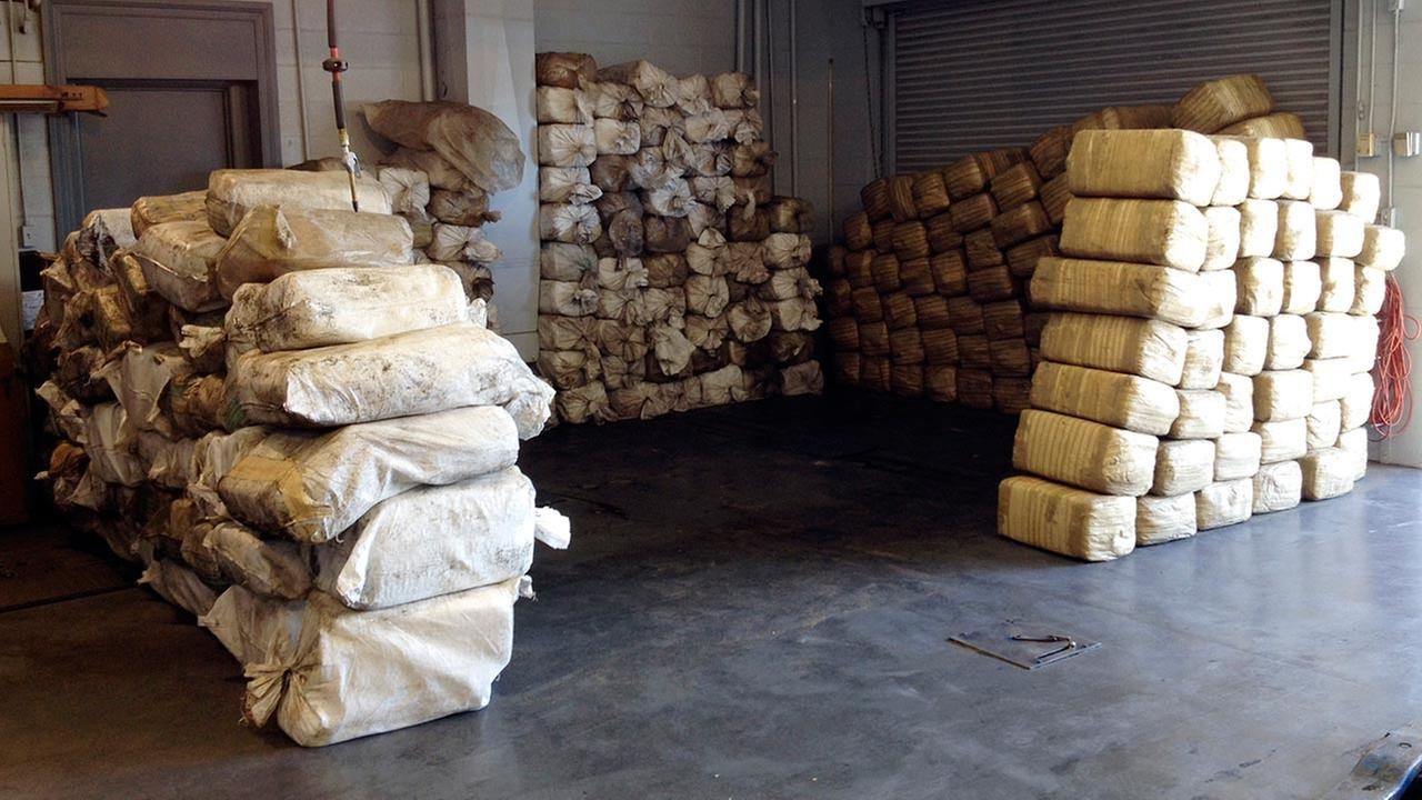 This Wednesday, July 9, 2014 photo provided by the Bakersfield Police Department shows bales of marijuana seized from a truck near Bakersfield