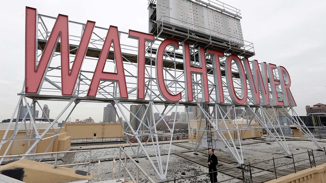 Watchtower sign is seen on the roof of 25-30 Columbia Heights, the current world headquarters of the Jehovahs Witnesses, in the Brooklyn borough of New York.