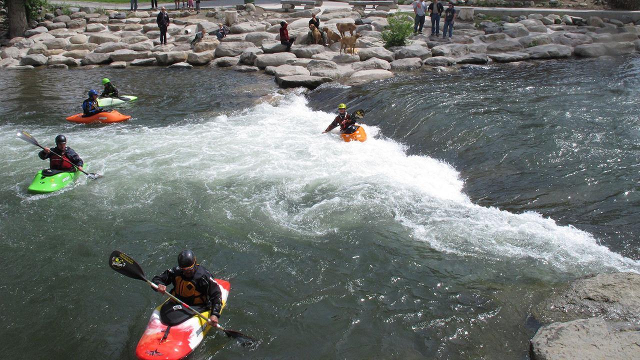 FILE: Kayakers enjoy the rapids in the Truckee Rivers peak flow of the season at a park in downtown Reno, Nev