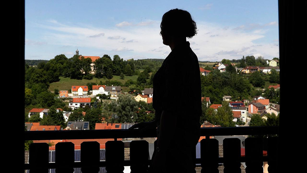 In this July 29, 2017 photo transgender U.S. army captain Jennifer Sims is silhouetted on a balcony after an interview with The Associated Press in Beratzhausen