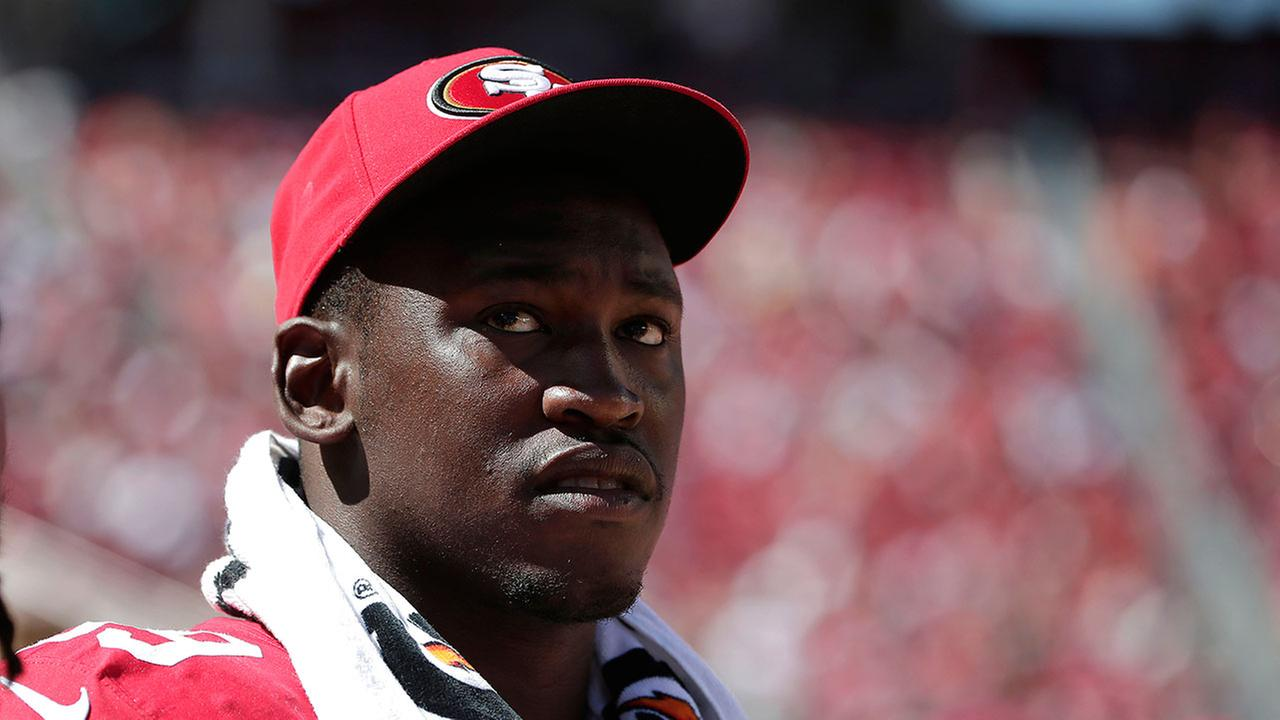 FILE - In this Aug. 17, 2014, file photo, San Francisco 49ers linebacker Aldon Smith (99) watches from the sideline during the second half of an NFL preseason football game