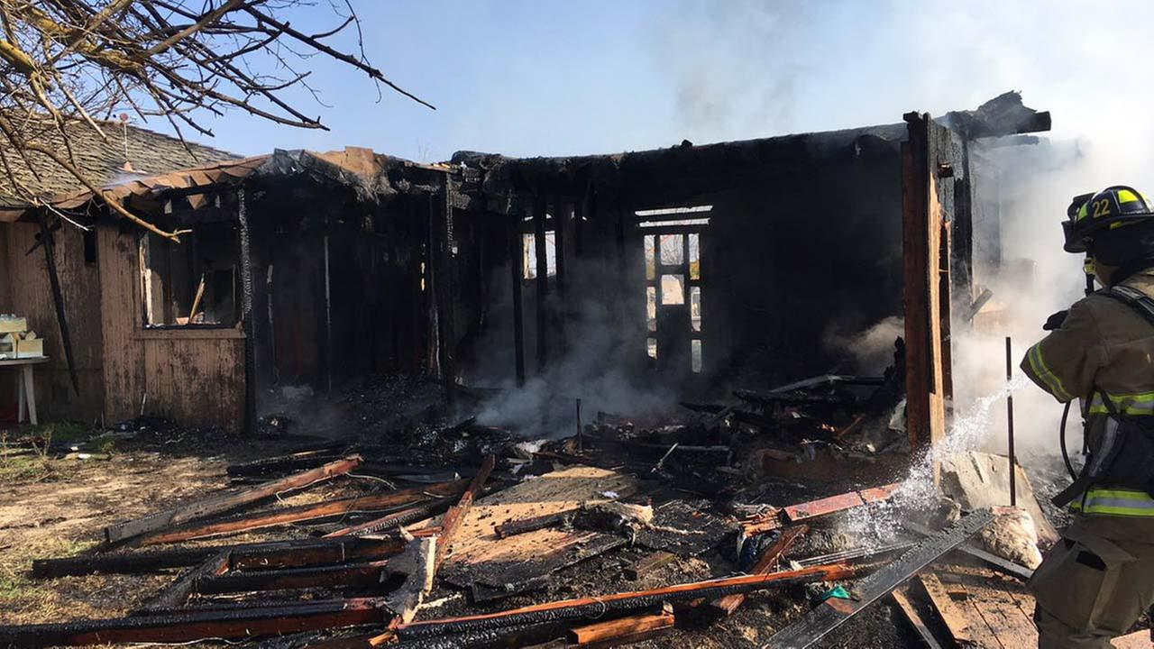 Fire crews battled a house fire Monday morning west of Kerman in Fresno County.