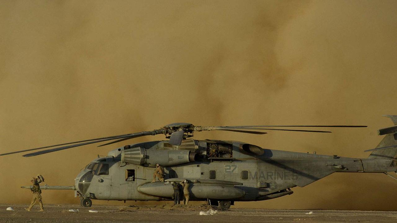 (FILE) A huge cloud of dust billows up behind a Marine CH-53E Super Stallion helicopter at Camp Rhino in southern Afghanistan, in this Dec. 8, 2001, photo.