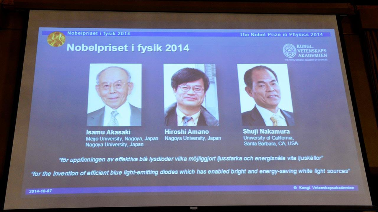 Projected images of Isamu Akasaki, Hiroshi Amano and Shuji Nakamura are displayed as its announced at the Royal Swedish Academy of Science in Stockholm