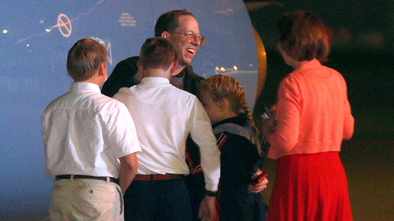 Jeffrey Fowle is greeted by family members upon his arrival, early Wednesday, Oct. 22, 2014, at Wright-Patterson Air Force Base, Ohio.