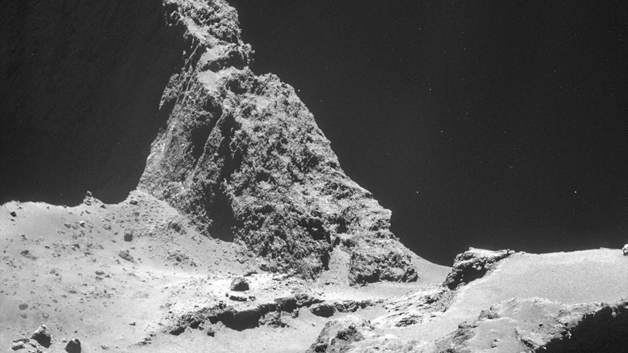 The picture taken with the navigation camera on Rosetta and released by the European Space Agency ESA shows the boulder-strewn neck region of Comet 67P/Churyumov-Gerasimenko