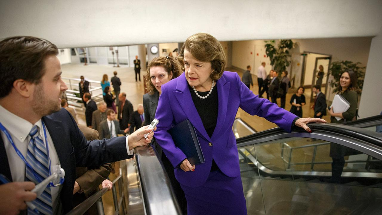 Senate Intelligence Committee Chair Sen. Dianne Feinstein, D-Calif. is pursued by reporters on Capitol Hill in Washington as she arrives to release a report on harsh interrogation