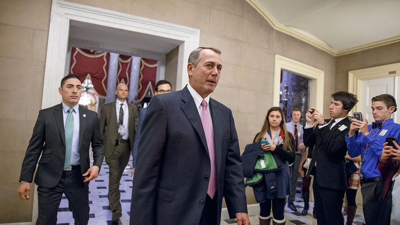 House Speaker John Boehner of Ohio returns to his office on Capitol Hill in Washington