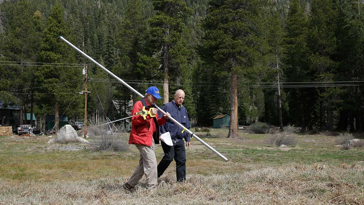 Frank Gehrke, chief of the California Cooperative Snow Surveys Program for the Department of Water Resources, and Gov. Jerry Brown conducts the snow survey, near Echo Summit, Calif