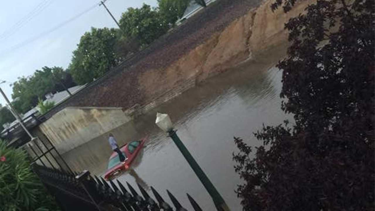 An #abc30insider took a pic of a woman stuck on the roof of her car on Maroa and Shields in Central Fresno.