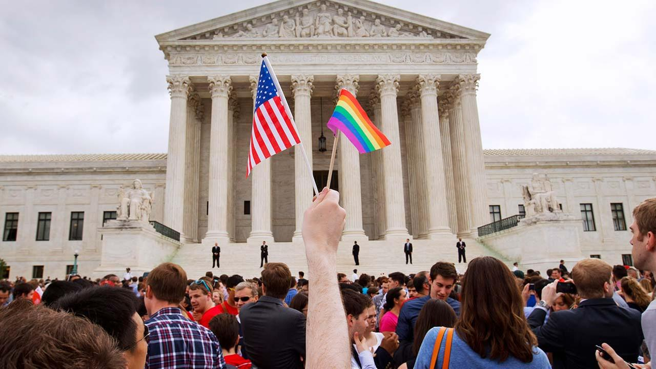 The crowd celebrates outside of the Supreme Court in Washington