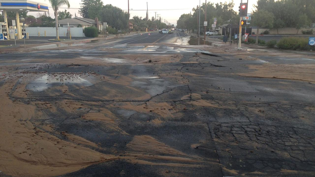 Water main break damages road at Clinton and Fruit intersection.