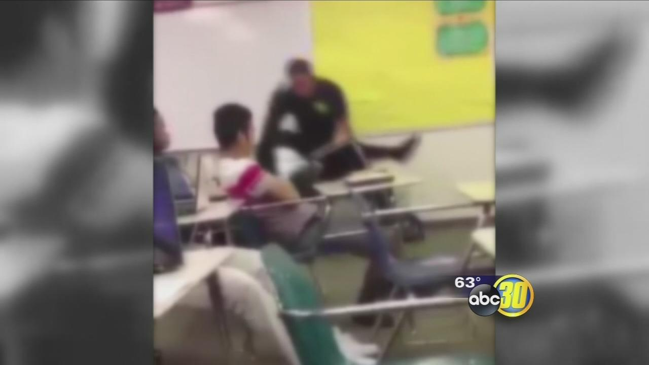 Video shows school officer tossing student in classroom