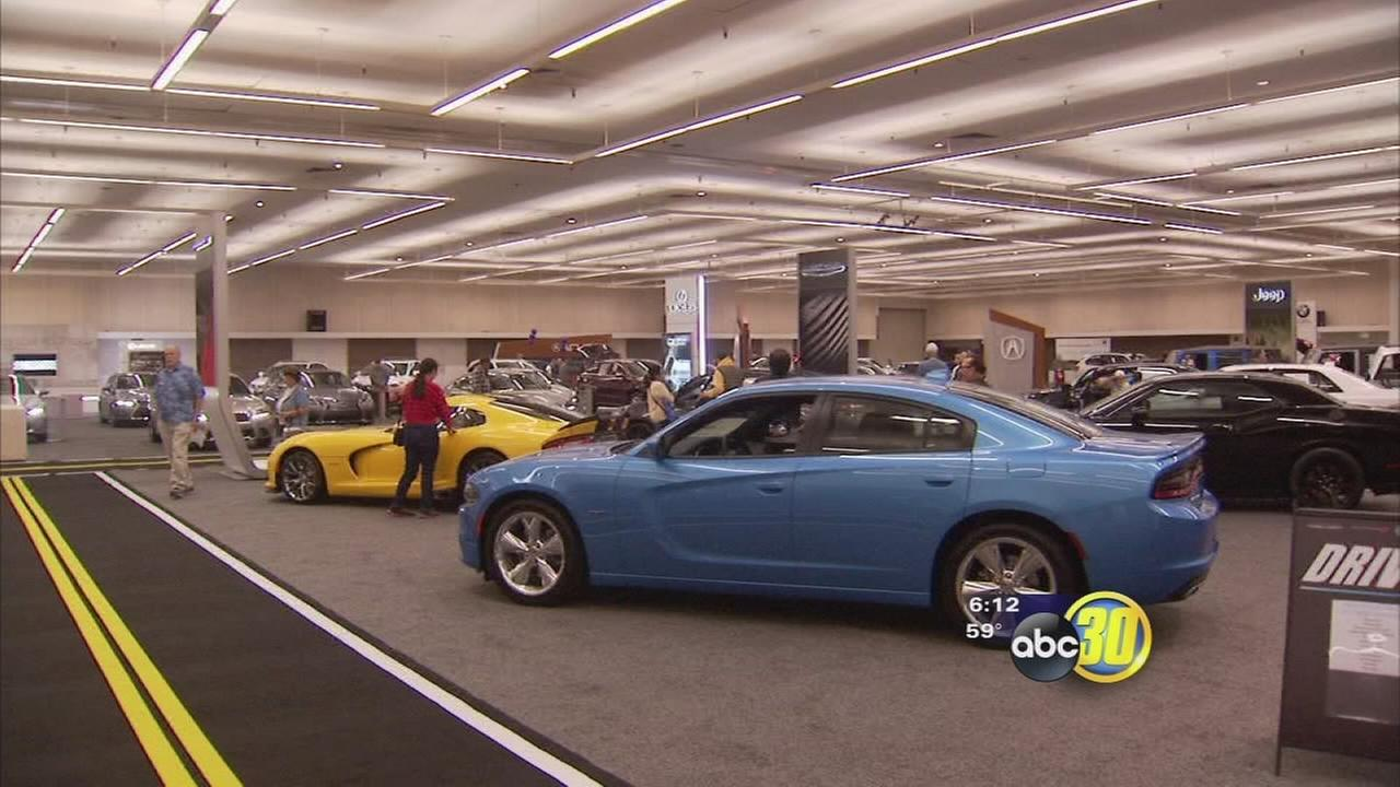 Curious car buyers and check out dozens of cars at the Central California Auto Show