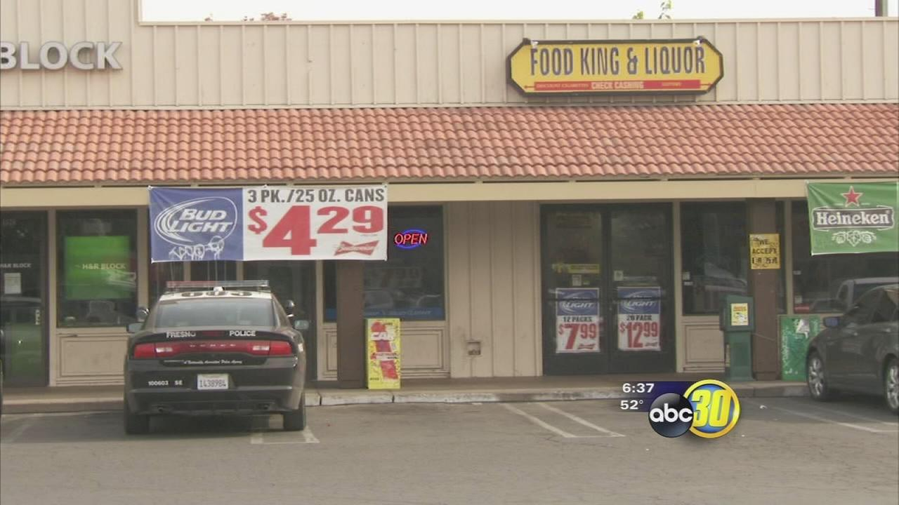 Woman badly beaten during liquor store robbery in Central Fresno