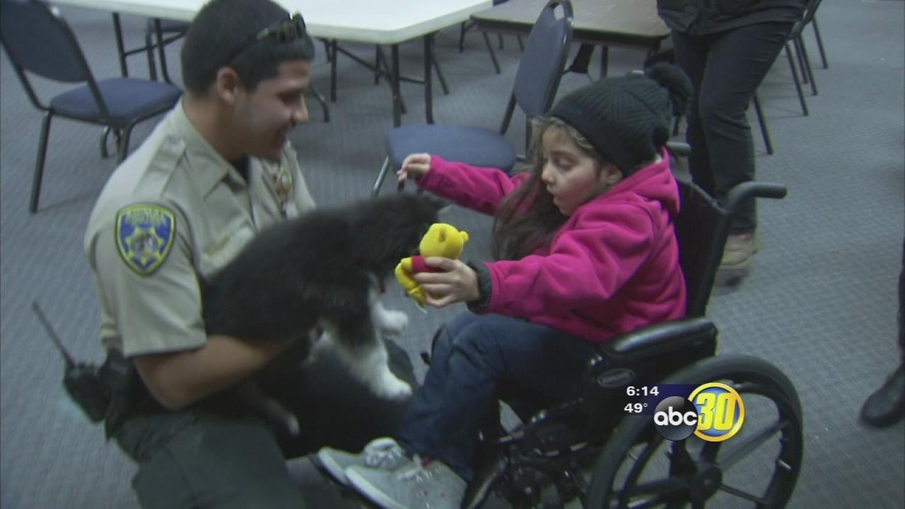 Eight-year-old girl battling brain cancer reunited with missing puppy