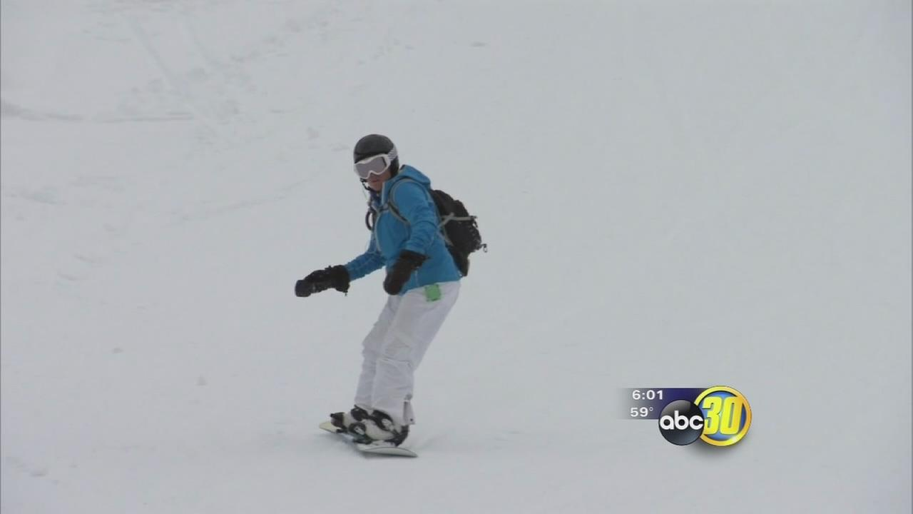 Snowy weather means skis and snowboards for valley residents