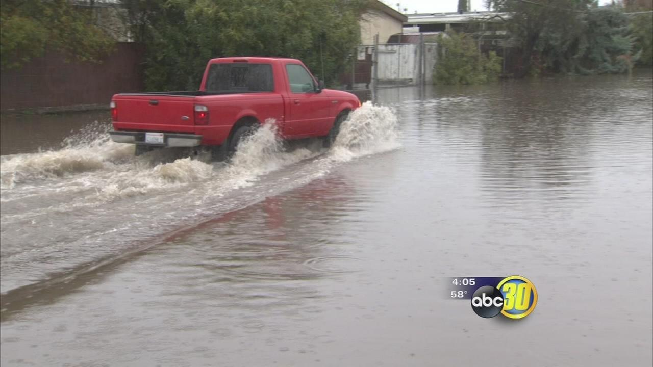 Storm causes Fresno residents to face flooded streets, power outages, and potholes