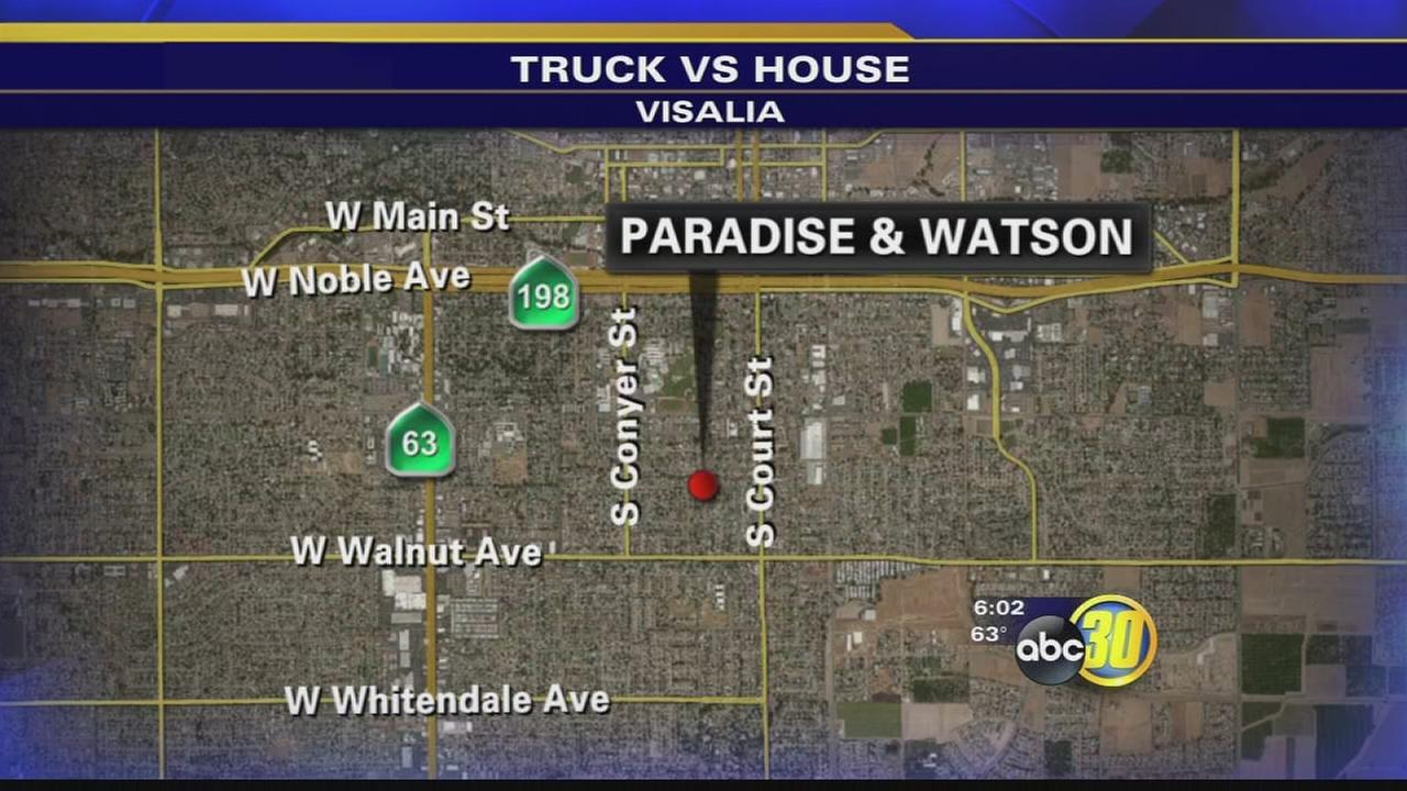 Truck slams into Visalia home