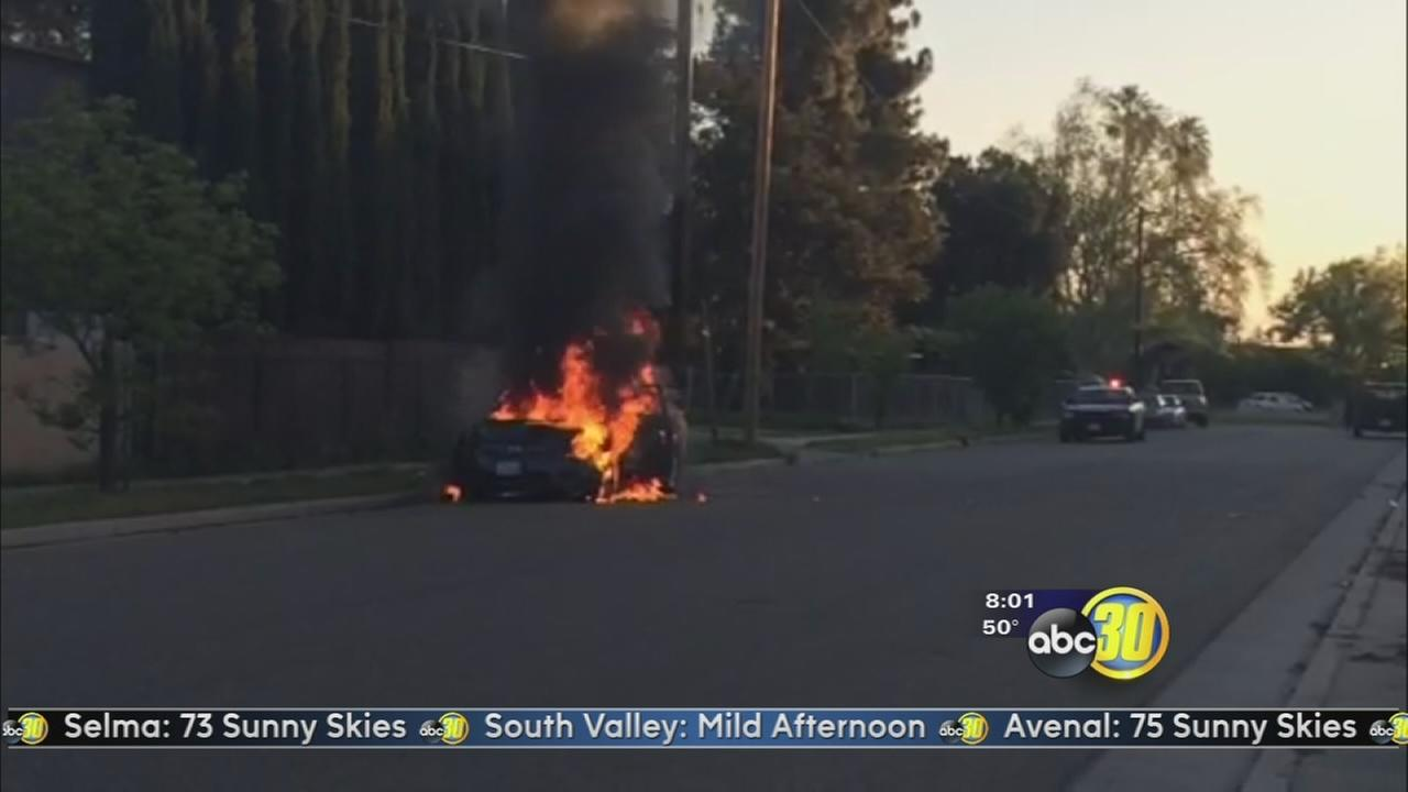 Crews put out large car fire near HWY 180