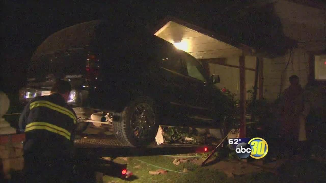 A truck crashed into the living room of a Laton home Sunday night.