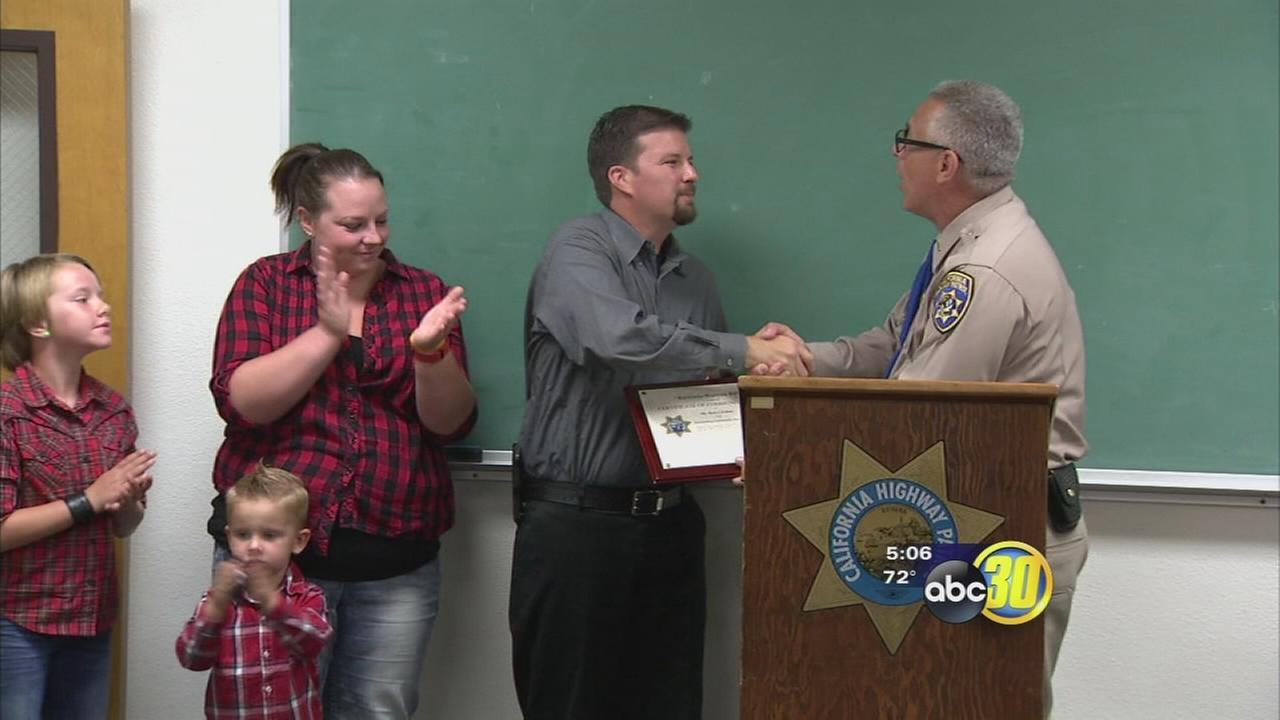 Madera man honored for saving Clovis family from burning car