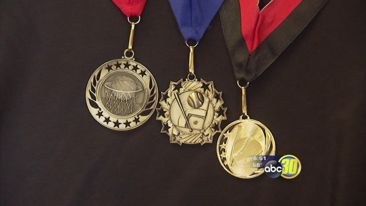 Participation medals for kids in sports continue to get mixed reviews from parents