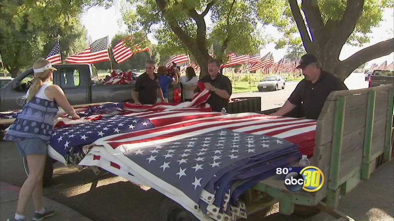 Volunteers for Avenue of Flags serving at home while their loved ones serve overseas