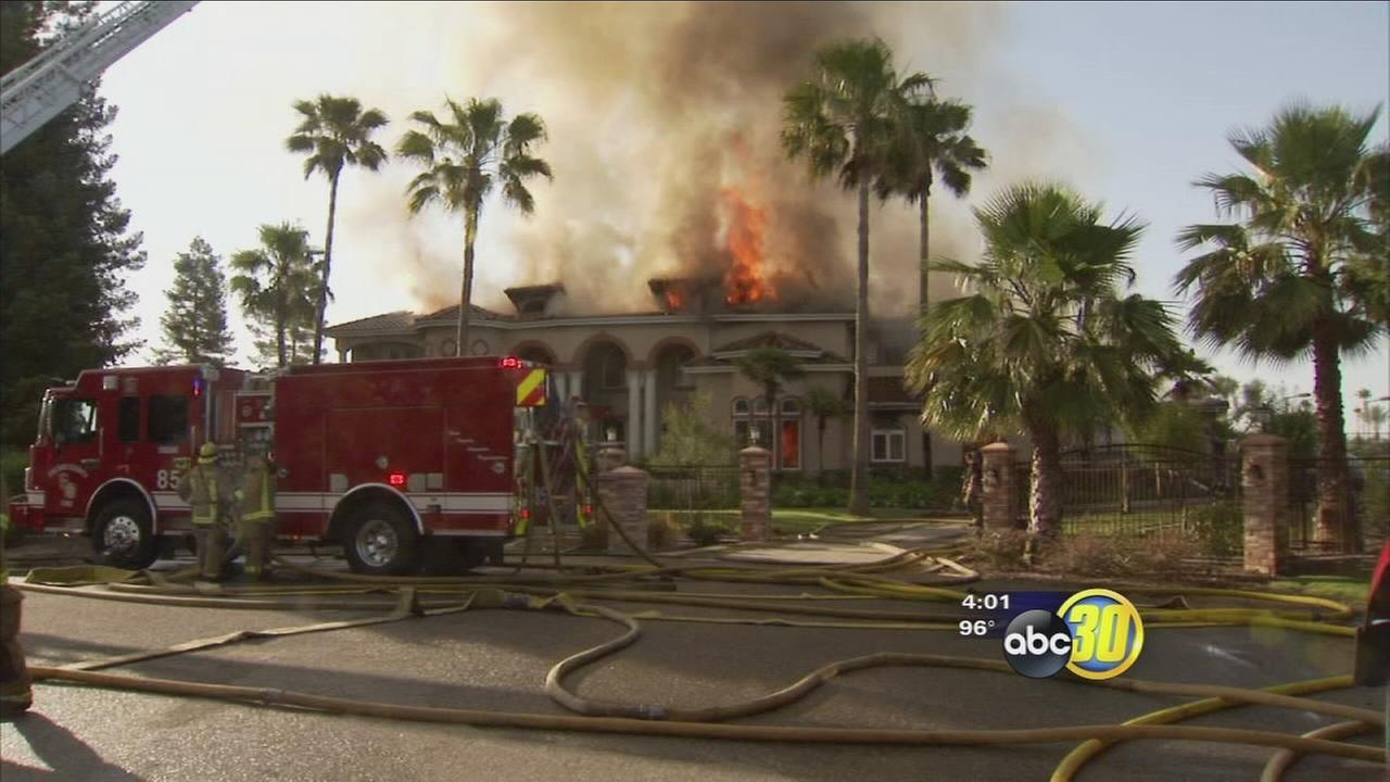 Fire tears through large Fresno County home
