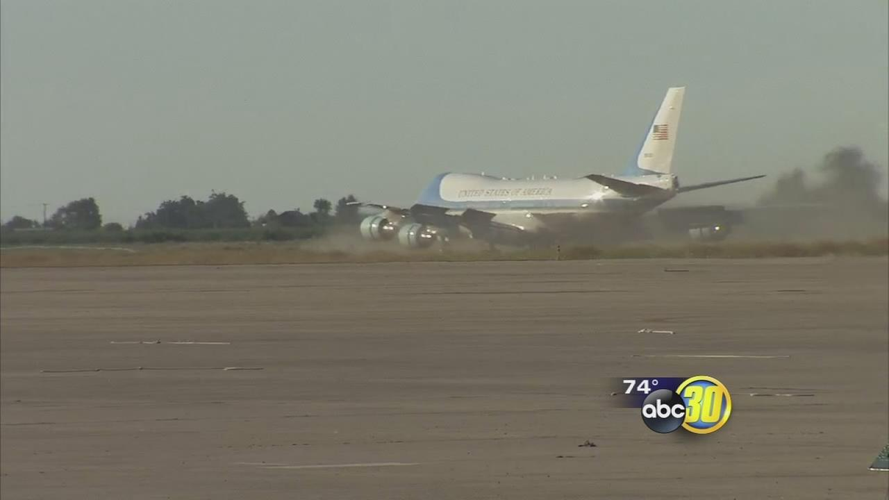 The President and First Family steps off plane at Castle Airport and into history