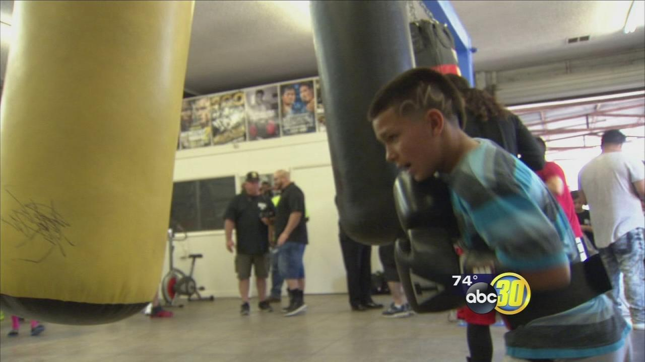 Boxing gym reopens at bigger location that was shut down to make way for High-Speed Rail
