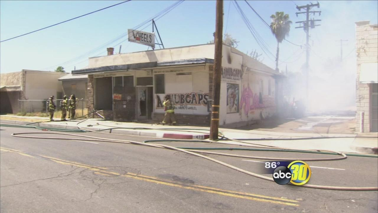 Off-duty officer saves man from abandon business fire in Central Fresno