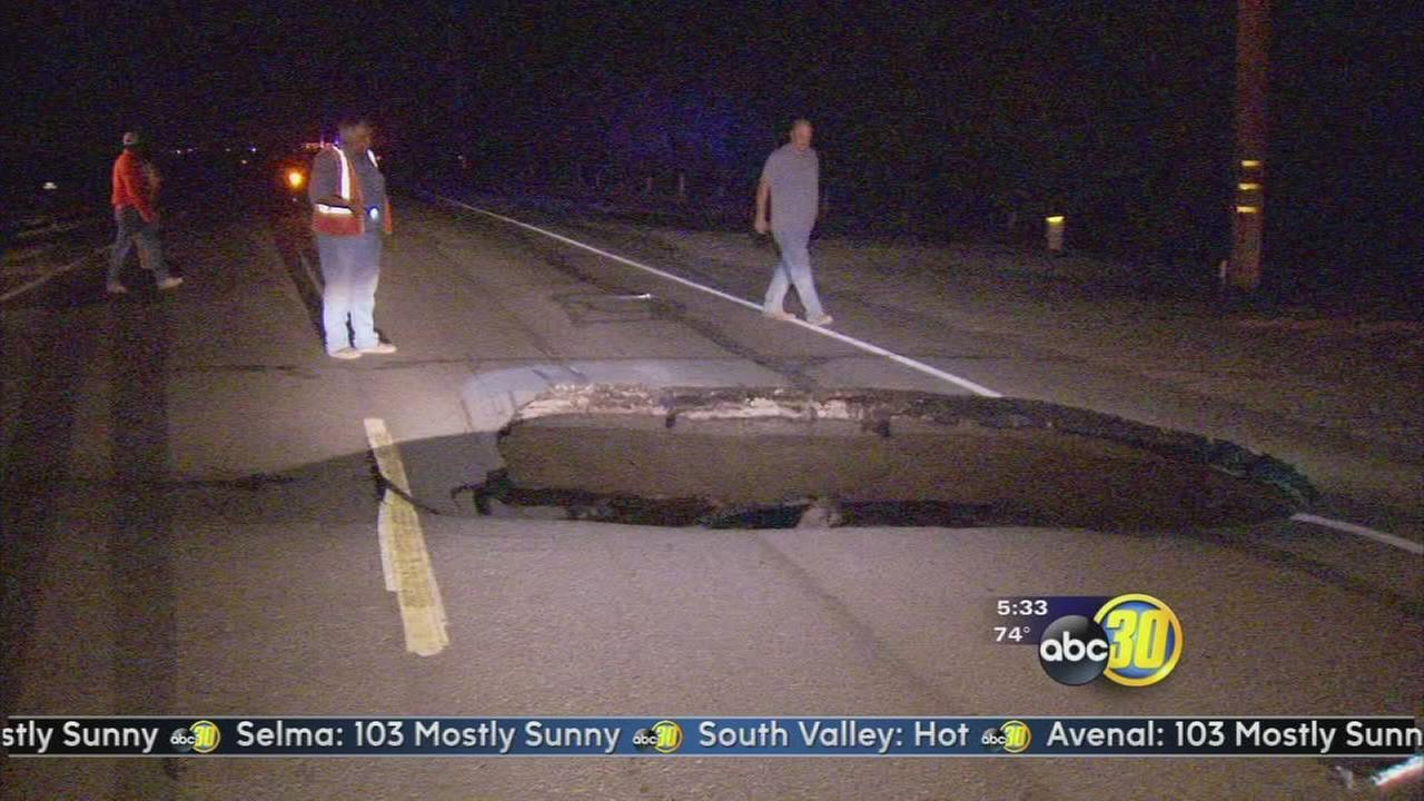 Sinkhole opens up on Kings County road damaging 2 cars