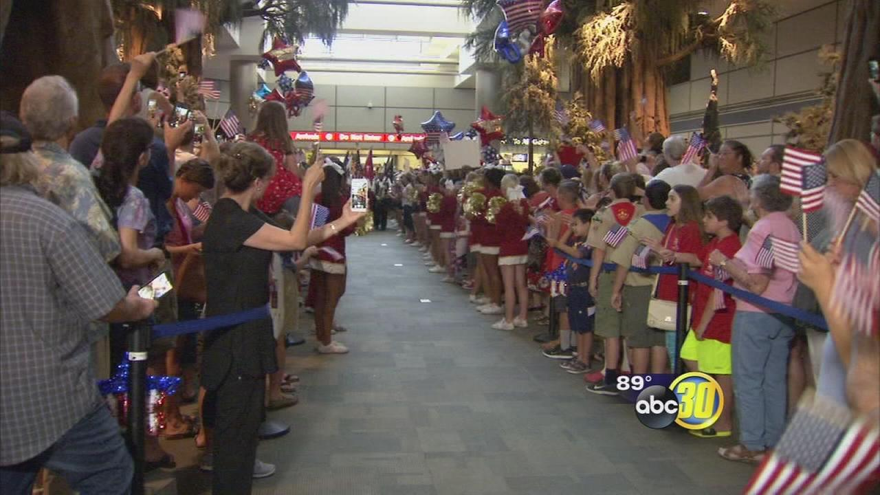 Cheering crowds greet veterans in Fresno as they return from Central Valley Honor Flight
