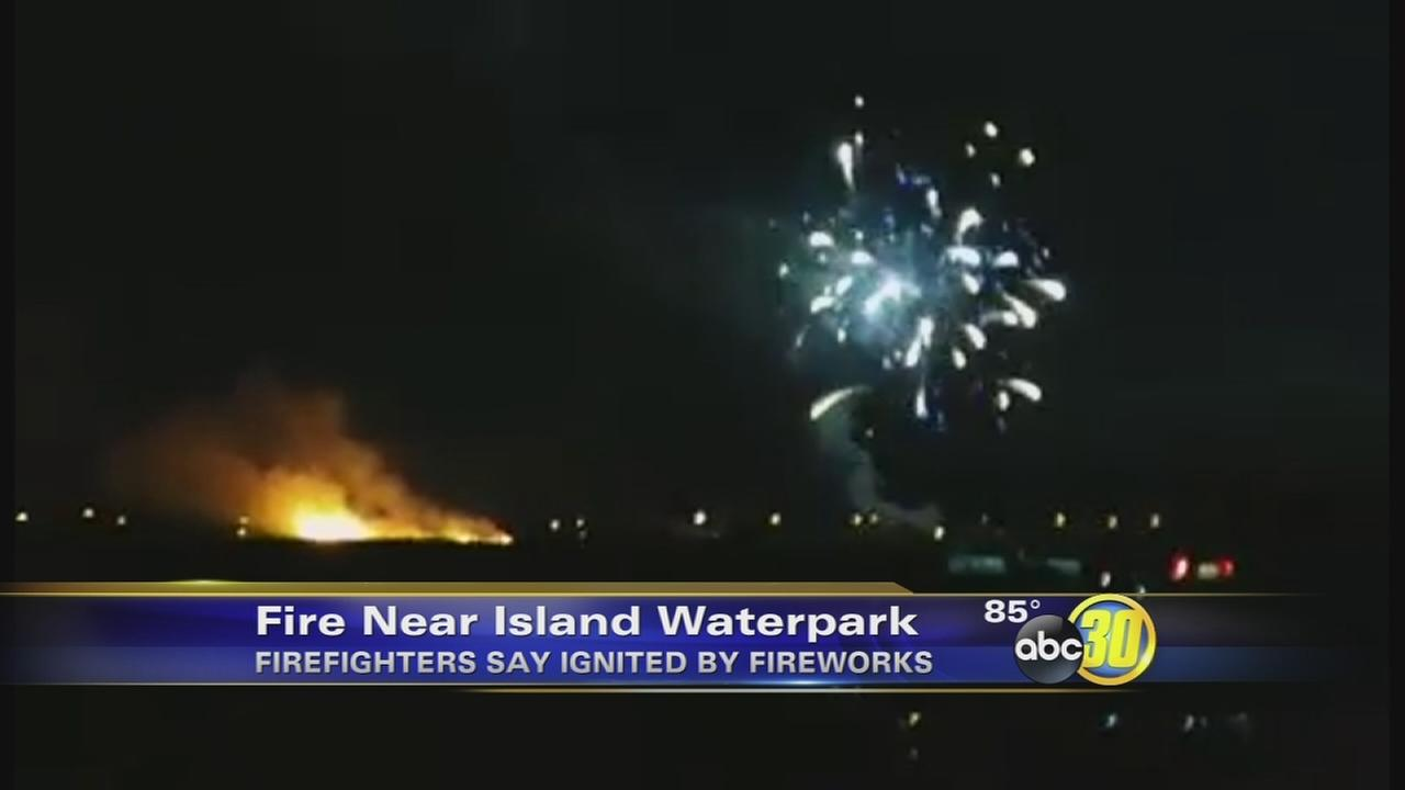 Grass fire sparked by fireworks burns near Island Water Park