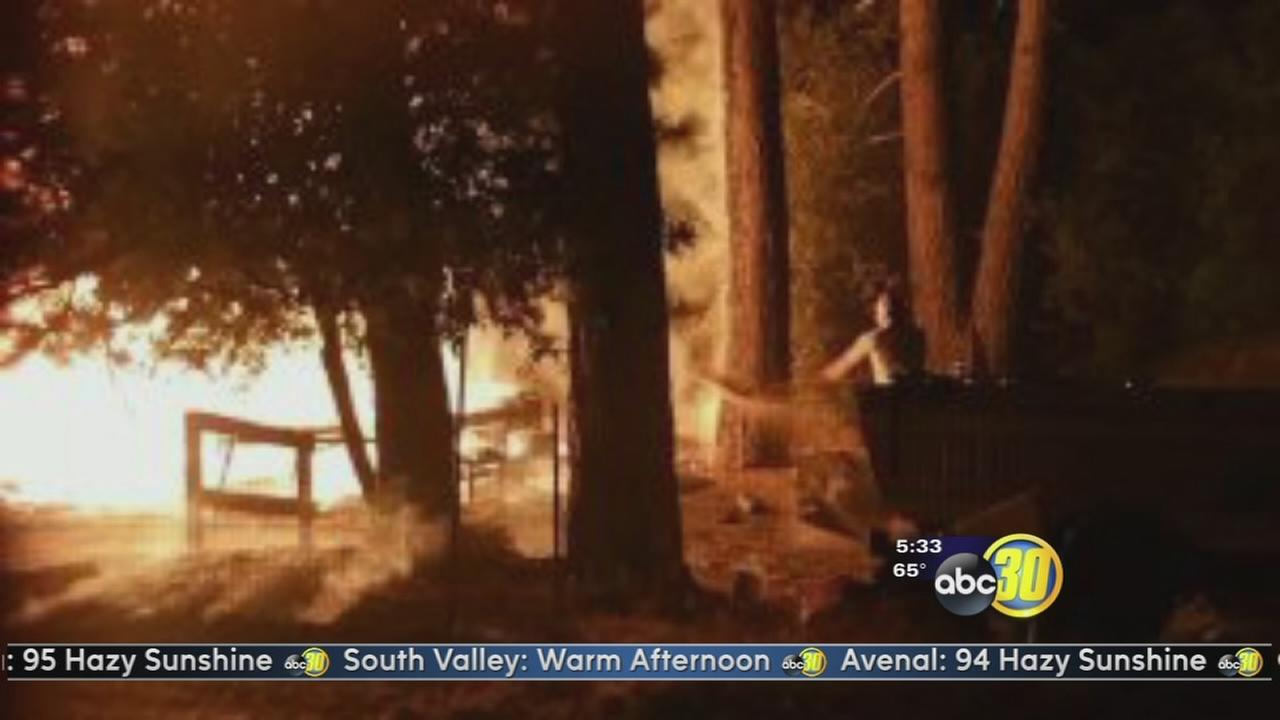 Neighbors use water buckets to stop spread of a fire near North Fork