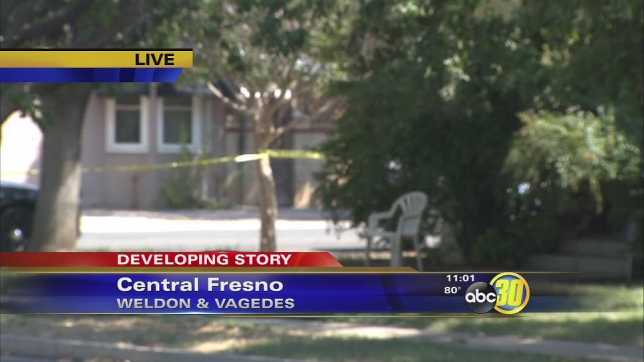 Police investigate a homicide in Central Fresno
