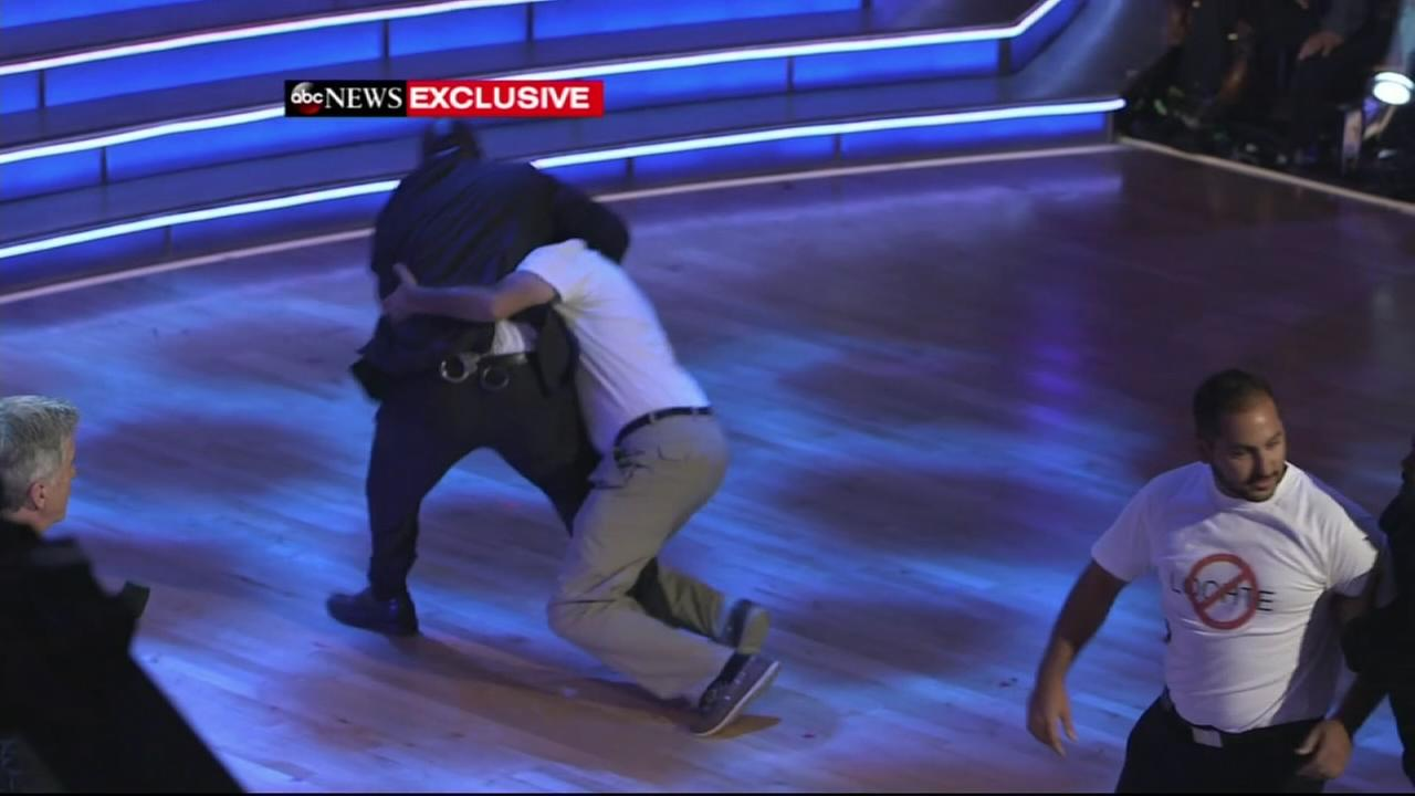 Ryan Lochte protestors tackled on stage at Dancing with the Stars